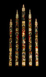 Stain Glass Windows. The tall stain glass windows in a church Stock Image