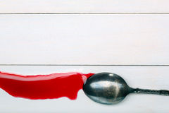 Stain of red juice flowing down from spoons Royalty Free Stock Image