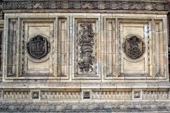 Stained Bas Relief Marble Carving, Albert hall, London, UK. A pollution stained white marble bas relief stone sculpture or carving, outside Royal Albert hall royalty free stock images