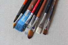 Stained brushes on canvas Royalty Free Stock Image