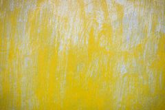 Stained bulge yellow door background.  royalty free stock photo