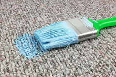 Stained carpet with paint brush Stock Photo