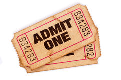 Old torn admit one movie tickets isolated white background. Old admit one tickets on a white background Stock Photography