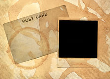 Stained ephemera. Stained postcard and instant image on an old photo album page Royalty Free Stock Photos