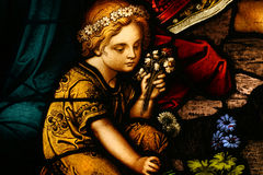 Stained Glass. Beautiful stained glass of a little girl and flowers Stock Photography
