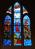 Stained glass. With colorful religious scenes in a Madrid church, Spain Royalty Free Stock Photo