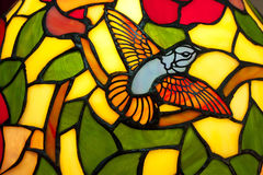 Stained Glass. A bird in stained glass of  lamp
