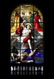 Stained glass. Ancient stained glass of the cathedral of milan, in italy royalty free stock photo