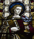 Stained Glass. Window depicting St. John, at St. John's Church, Monkstown, Co. Cork. Church completed in 1838 Royalty Free Stock Image