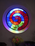 Stained glass. Beautiful window at the extraordinary Hundertwasser church in Pieber, Austria Stock Image