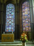 Stained glass and altar of a church Stock Photography