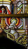 Stained Glass - Angel and a Celtic harp. Stained Glass window depicting an Angel playing a Celtic harp, symbolizing Ireland, in the Cathedral of Saint Bavo in stock images