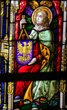 Stained Glass - Angel holding a shield. Stained Glass window depicting an Angel holding a shield with a phoenix in the Cathedral of Saint Bavo in Ghent, Flanders stock photography