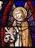 Stained Glass - Angel and the Lion of Flanders. Stained Glass window depicting an Angel holding the Flemish Lion in the Cathedral of Saint Bavo in Ghent royalty free stock photos
