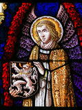 Stained Glass - Angel and the Lion of Flanders. Stained Glass window depicting an Angel holding the Flemish Lion in the Cathedral of Saint Bavo in Ghent stock photos