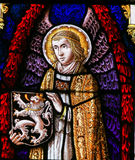 Stained Glass - Angel and the Lion of Flanders. Stained Glass window depicting an Angel holding the Flemish Lion in the Cathedral of Saint Bavo in Ghent royalty free stock images