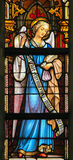 Stained Glass - Angel with purse Royalty Free Stock Photography