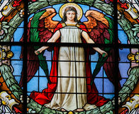 Stained Glass of an Angel. Stained glass window depicting an angel in the German Church in Gamla Stan, Stockholm royalty free stock images