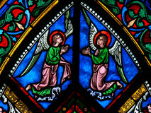 Stained Glass - Angels with Wings. Stained Glass window in the Cathedral of Caen, Normandy, France, depicting Two Angels with Wings royalty free stock photos