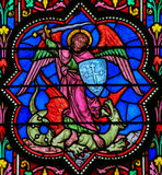 Stained Glass - the Archangel Michael vanquishing Satan Royalty Free Stock Photo