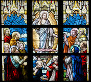 Stained Glass - Ascension of Jesus. Stained Glass window depicting the Ascension of Jesus Christ in the Church of Alsemberg, Belgium Royalty Free Stock Photography