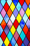 Stained glass background. Abstract colorful stained glass background of diamond shapes Stock Photos