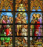 Stained Glass - Baptism of Christ. Stained Glass window (1860) in St Gummarus Church in Lier, Belgium, depicting the Baptism of Jesus by Saint John in the River Stock Photo
