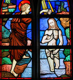 Stained Glass - Baptism of Jesus by Saint John the Baptist. Stained Glass in the Church of Tervuren, Belgium, depicting the Baptism of Jesus by Saint John the Stock Photography