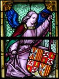 Stained Glass, Angel holding a Coat of Arms. Stained Glass in the Basilica of the Holy Blood in Bruges, Belgium, depicting an Angel holding the Coat of Arms of stock photography