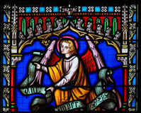 Stained Glass in Brussels Sablon Church - Angel. Stained Glass in the Church of Our Blessed Lady of the Sablon in Brussels, Belgium, depicting and Angel stock image