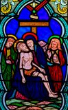 Jesus taken from the Cross. Stained Glass in the Cathedral of Monaco, depicting the Dead Body of Jesus taken from the Cross on the lap of His Mother, the Virgin stock photos