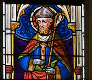 Stained Glass - Catholic Saint. Stained Glass window depicting a Catholic Saint in Bishop& x27;s clothing, in the Cathedral of Saint Bavo in Ghent, Flanders Stock Photography