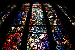 Stained glass in church. Photo of colorful stained glass in Gothic Catholic church Stock Photography