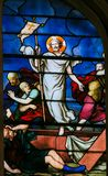 Jesus rising from the grave - Stained Glass. Stained Glass in the Church of Saint Severin, Latin Quarter, Paris, France, depicting Jesus rising miraculously from stock photo