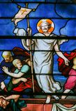 Jesus rising from the grave - Stained Glass. Stained Glass in the Church of Saint Severin, Latin Quarter, Paris, France, depicting Jesus rising miraculously from royalty free stock photo