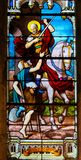 Stained Glass in Paris - St Martin of Tours. Stained Glass in the Church of Saint Severin, Latin Quarter, Paris, France, depicting St Martin of Tours handing out stock images