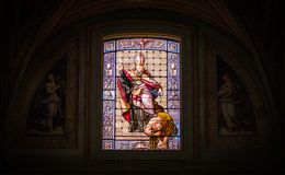 Stained glass in the Church of Sant`Agostino in Rome, Italy. Sant`Agostino is a Roman Catholic church in the piazza of the same name near Piazza Navona, in the Royalty Free Stock Photo