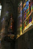 Stained glass church window. Light shining through stained glass church window. Statue Stock Photos