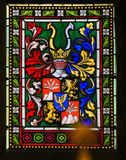 Stained Glass - Coat of Arms in Prague Cathedral Stock Image