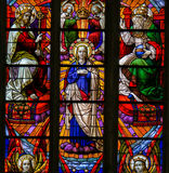 Stained Glass - Coronation of Mother Mary by the Holy Trinity. Stained Glass window depicting the Coronation of Mother Mary by the Holy Trinity, in the Cathedral Stock Image