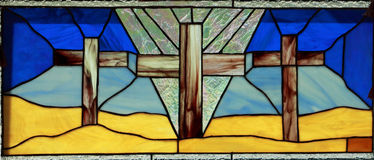 Stained Glass Crosses. Image of three crosses in stained glass window. Middle croaa is prominent Stock Photos