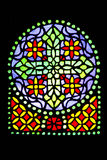 Stained glass detail. Very old stained glass with floral pattern Royalty Free Stock Image