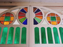 Stained glass door  in old church Royalty Free Stock Images