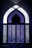 Stained Glass door with unique pattern and color in the mosque. royalty free stock image