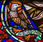 Stained Glass of the the Eagle - Saint John the Evangelist Royalty Free Stock Photography