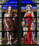 Stained Glass of Eve and Judith Stock Photo