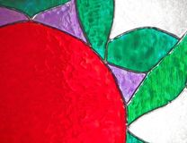 Stained glass flower. Red purple and green flower on stained glass with a white background Stock Images
