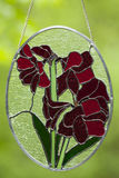 Stained Glass Flowers. Stained glass flower design isolated on green Stock Images