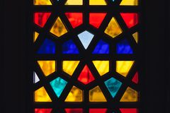 Stained glass with geometric Arabic pattern. Background photo texture Stock Photography