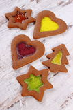 Stained glass gingerbread on old wooden background, christmas time Stock Photography
